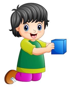 Karikaturmädchen, das Spielzeugwürfel spielt