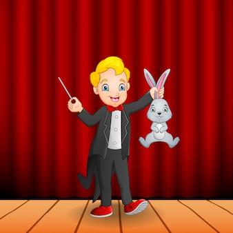 Karikaturmagier, der einen magischen stab und ein kaninchen hält