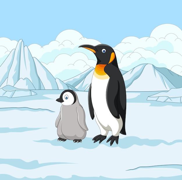 Karikaturmutter- und -babypinguin auf schneebedecktem feld