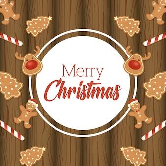 Karte der frohen weihnachten mit süßen ingwerplätzchen auf holz