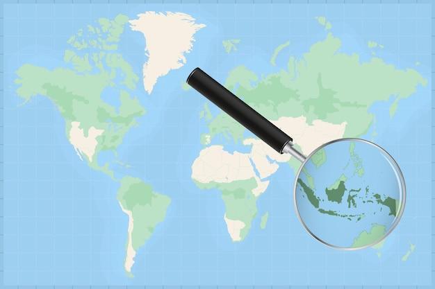 Karte der welt mit einer lupe auf einer karte von indonesien.