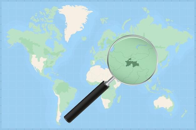 Karte der welt mit einer lupe auf einer karte von tadschikistan.