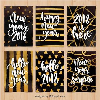 Karten aquarell des neuen jahres 2018 in gold und in schwarzem