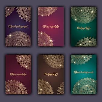 Kartensatz mit glühendem dekorativem mandalaelementmit blumenhintergrund