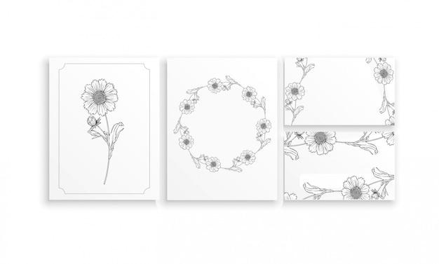 Kartenstapel und visitenkarten mit grafischen blumengestecken mit mit kamillenblumen