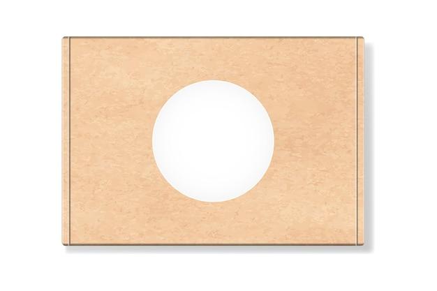 Kartonverpackungsbox mit rundem leerem etikett lokalisiert auf weißem hintergrund.