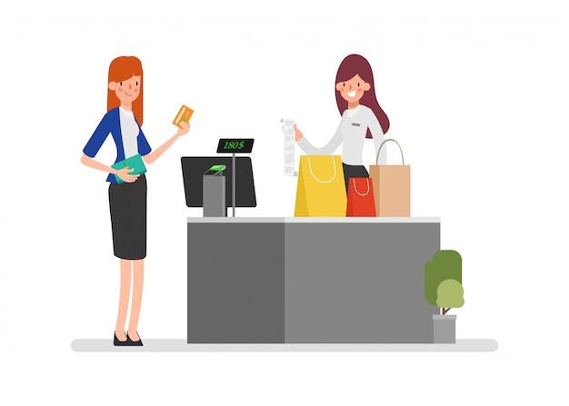 Kassierer akzeptiert zahlung für den kauf mit einer karte und kundendienst.