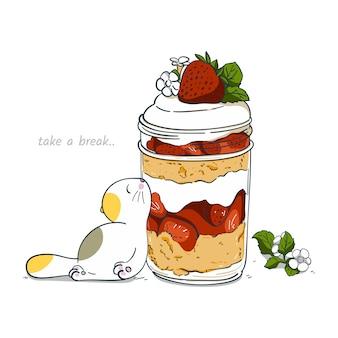 Katze des handabgehobenen betrages mit erdbeereshortcake