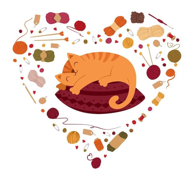 Katze, die auf kissen im herzförmigen rahmen schläft. herbst gemütlichkeit, ruhekonzept. strick hobbyzubehör grenze. kitty liegt auf dem kissen.