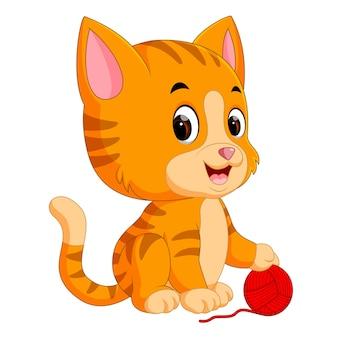 Katze spielt mit ball aus garn