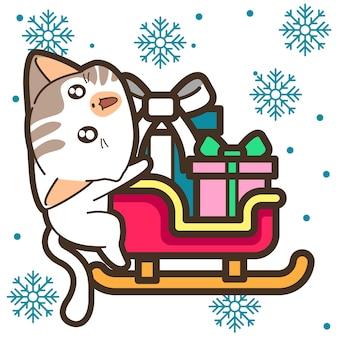 Katze und geschenk auf schlitten am weihnachtstag
