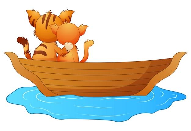 Katzen der karikatur zwei in einem boot