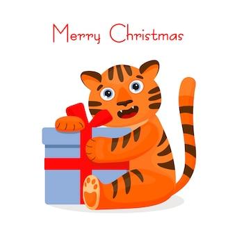 Katzentiger umarmt ein geschenk. weihnachtskarte. zeichentrickfigur