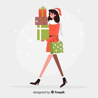 Kaufende weihnachtsgeschenke der jungen frau