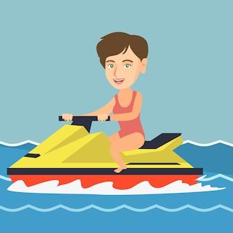 Kaukasische frau, die einen wasserfahrzeug im meer reitet