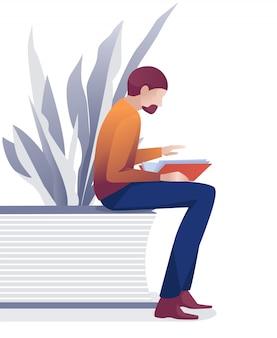 Kaukasischer bärtiger mann-leser, der mit buch sitzt