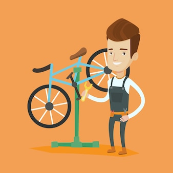 Kaukasischer fahrradmechaniker, der in der reparaturwerkstatt arbeitet.