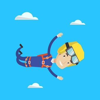 Kaukasischer fallschirmspringer, der mit fallschirm springt.