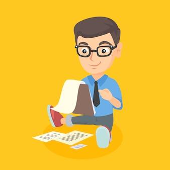 Kaukasischer junge, der mit einem geschäftsdokument arbeitet.