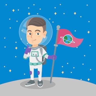Kaukasischer kinderraumfahrer mit flagge auf einem neuen planeten.