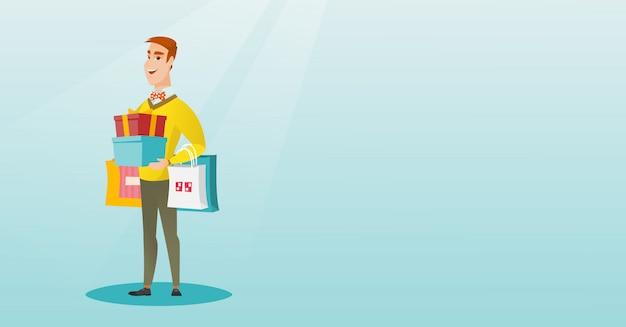 Kaukasischer mann, der einkaufstaschen und geschenkboxen hält