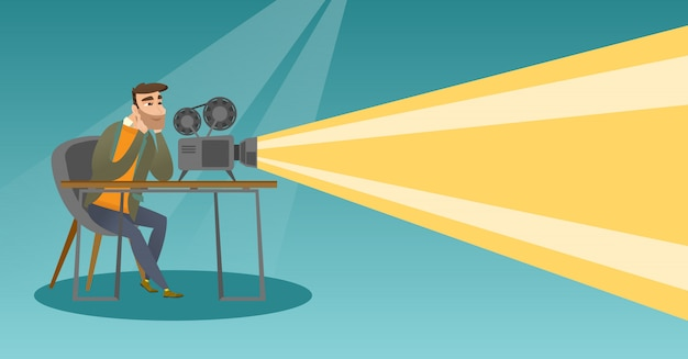 Kaukasischer projektor, der einen neuen film zeigt.