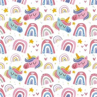 Kawaii niedliches einhorn und regenbogen nahtloses muster im skandinavischen stil.