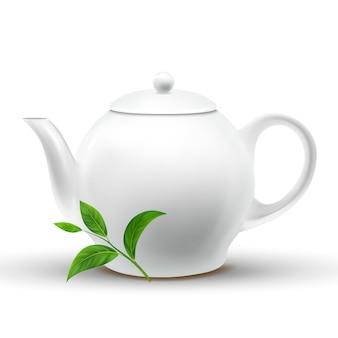 Keramische weiße teekanne mit grünem teeblatt