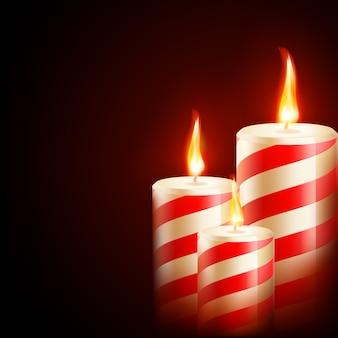 Kerzen auf dunklem hintergrund.
