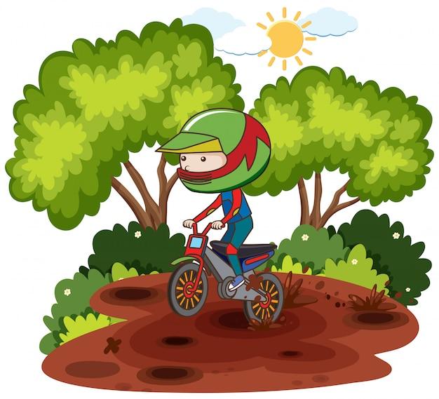 Kind, das dirtbike durch forrest reitet