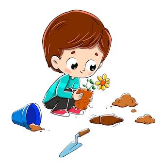 Kind, das eine anlage im boden pflanzt