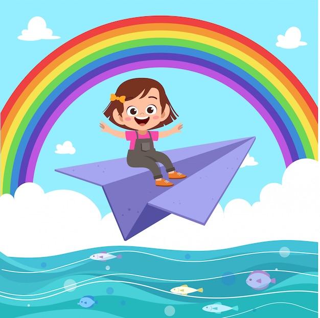 Kind mädchen fahren papierflugzeug
