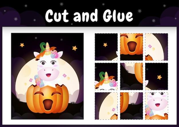 Kinder-brettspiel schneiden und kleben mit einem niedlichen einhorn im halloween-kürbis