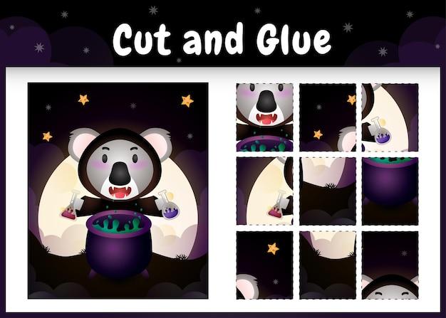 Kinder-brettspiel schneiden und kleben mit einem süßen koala im halloween-kostüm