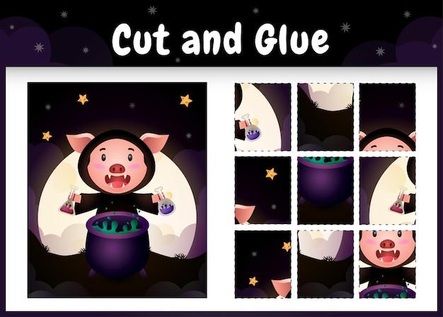 Kinder-brettspiel schneiden und kleben mit einem süßen schwein im halloween-kostüm Premium Vektoren