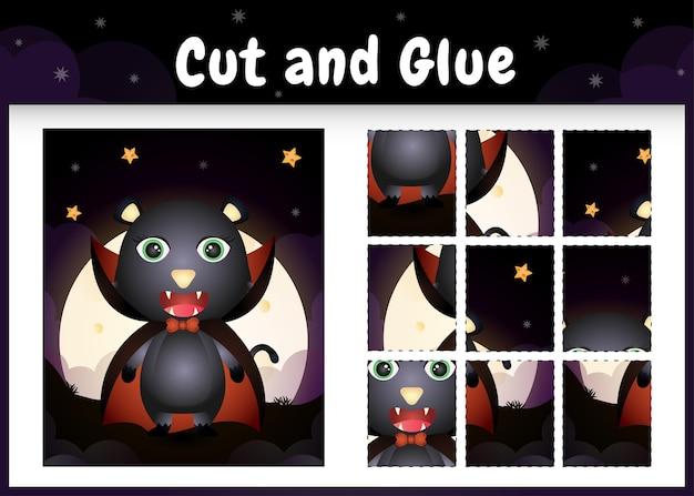 Kinder-brettspiel schneiden und kleben mit einer süßen schwarzen katze im halloween-dracula-kostüm