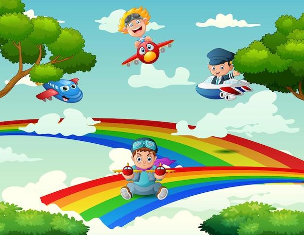 Kinder, die ein flugzeug auf einem regenbogen spielen