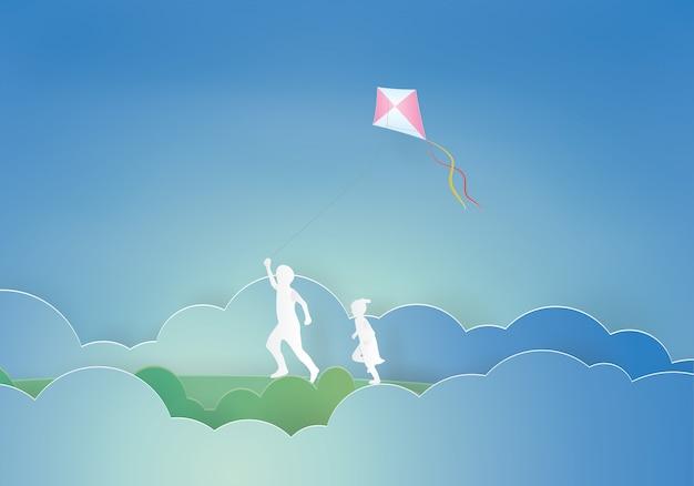 Kinder, die einen drachen fliegen