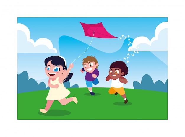 Kinder, die mit einem drachen lächeln und spielen