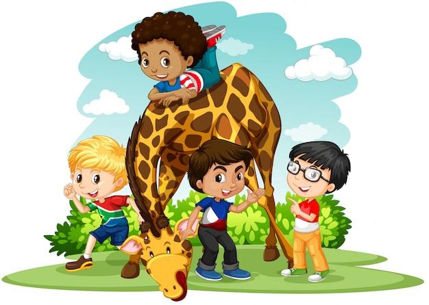 Kinder, die mit giraffe spielen
