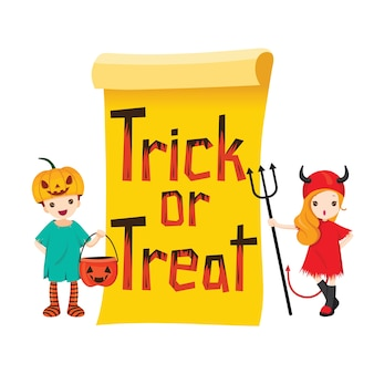 Kinder im halloween-kostüm mit süßes oder saures-banner