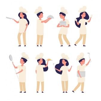 Kinder kocht. glücklicher junge, mädchen kleine chefkocher, süße kinder in uniform, die in der küche kochen.