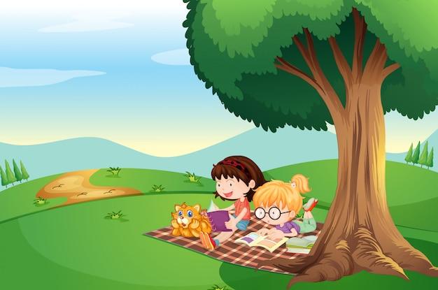 Kinder lesen unter dem baum mit einer katze