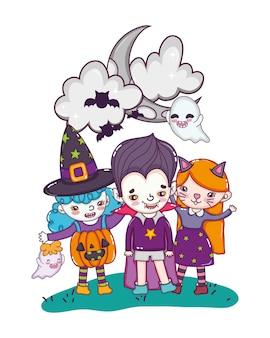 Kinder mit lustigen kostümen und gespenstern mit fledermäusen