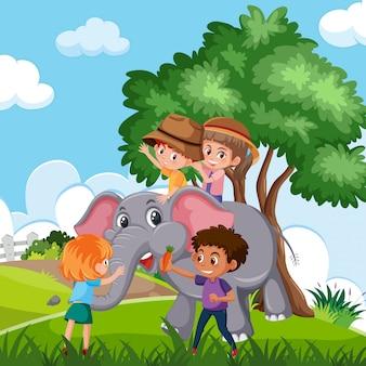 Kinder reiten elefanten in der natur
