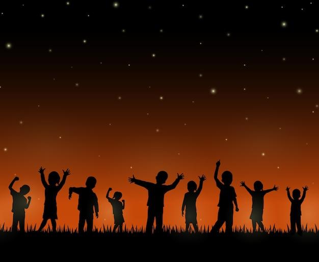 Kinder silhouettieren auf dem nachthintergrund