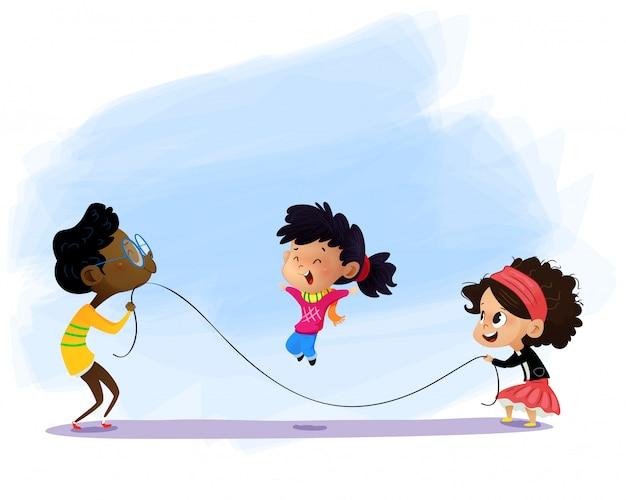 Kinder spielen springseil.