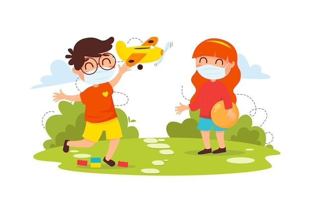 Kinder spielen zusammen, während sie medizinische masken tragen