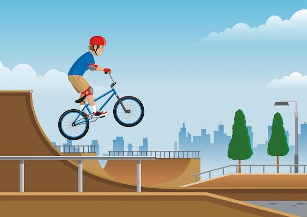 Kinder springen auf bmx-fahrrad im skatepark