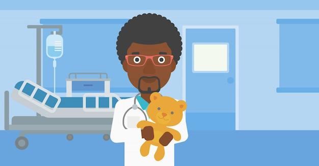 Kinderarztdoktor, der teddybären hält.